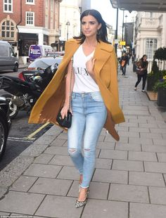 Denim diva: Lucy showed off her flawless style credentials and her sensational figure in her skin-tight distressed jeans which featured a light wash and ripped knees