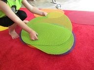 "Placemats used as ""spots"" for circle time. Much easier to find than those carpet squares.."