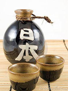 Ceramic Sake Bottle and Cups by K7335, via Dreamstime