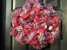 Red & White Gingham with Red & White Ribbons and Tin Santa on this Deco Mesh Christmas Wreath