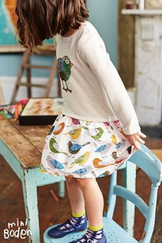 Twit twoo. This sequined applique bird has us all of a twitter. A woven skirt and thick sweatshirt top make this dress suitable to wear around town with boots, or along muddy paths in wellies.