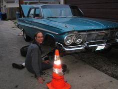 """1961 Chevrolet Impala  Chicago can be so wonderful.  My wife and I met this man on July 3 fixing his car in a Chicago alley.  He gladly sad """"yes"""" to a picture."""