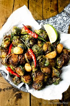 SAVE FOR LATER! These Coconut Oil Fried Brussels Sprouts are the best fried Brussels sprouts I've ever eaten. They're fried in healthy coconut oil with garlic and chilies and served with fresh lime. They are so delicious that you'll want to pop them like candy! #theendlessmeal #paleo #vegan #vegetarian #glutenfree #paleosnacks #paleoappetizers #vegansnacks #veganappetizers #vegetarianappetizers #vegetariansnacks #lowcarb #paleosidedish #vegansidedish #vegetariansidedish #vegetables Vegetarian Appetizers, Healthy Dinner Recipes, Vegetarian Recipes, Vegan Snacks, Drink Recipes, Vegetable Sides, Side Dish Recipes, Vegetarian Side Dishes, Brussels Sprouts