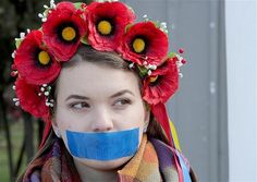 March 13, 2014: Crimea region, A local woman with her mouth symbolically taped at a rally in Simferopol, Ukraine.
