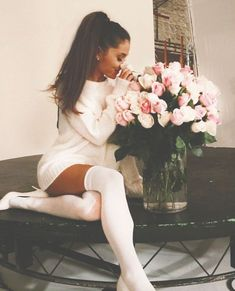 Ariana Grande sniffing some pretty flowers.:).