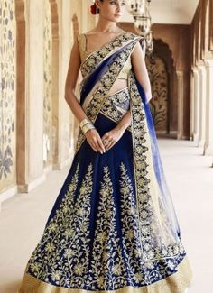 Blue Art Silk embroidered wedding party wear lehenga choli. Blue color lehenga crafted with heavy zari embroidery and lase patch border. Choli material art silk with blue border. Dupatta material net.