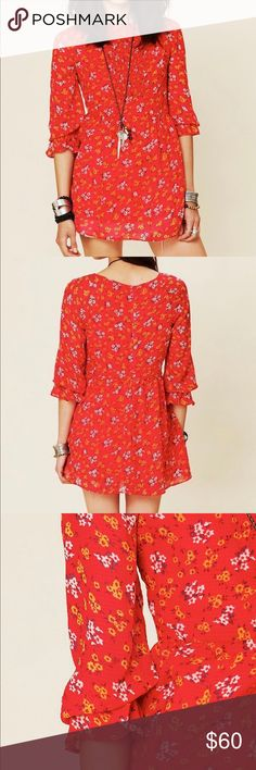 """Free People """"Court Me with Flowers"""" floral tunic Free People """"Court Me with Flowers"""" floral tunic top. Bright red blouse with yellow and white all over floral print. Flowy, lightweight, chiffon material. Quarter length ruffle trim sleeve. EUC, excellent used condition. Size tag has been cut out but is a size 4. Measurement- 18 1/2"""" bust, 29"""" length. Free People Tops Tunics"""
