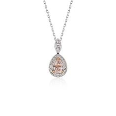 This elegant one-of-a-kind pendant features a pear-shaped fancy light brownish-pink diamond framed by a halo of round diamonds in 18k white gold with a matching cable chain necklace.