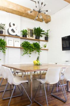 """To bring life into the office, particularly the breakout dining area, they brought in plants from local <a href=""""https://sprouthome.com/"""" target=""""_blank"""">Sprout Home</a>."""