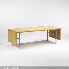 Drop-leaf coffee table, model #5057 sold by Wright, Chicago, on Saturday, October 02, 2004
