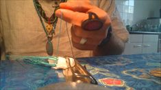 Wrapping a crystal stone with macrame
