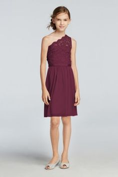 Just for junior bridesmaids, our scaled down version of this short mesh and lace bridesmaid dress comes with an optional spaghetti strap. Skirt falls just above the knee. Scalloped one shoulder illusion lace neckline creates a fun look! Fully Lined. Back Zipper. Dry Clean Only. Complements perfectly with style F15711. To protect your dress, try our Non Woven Garment Bag.