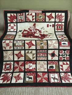 I made this Canada 150th Celebration quilt for good friends using Northcott Oh Canada collection. It's backed in warm plaid flannel. #quiltsinspiredbyeva #apqsmillenium #quilts