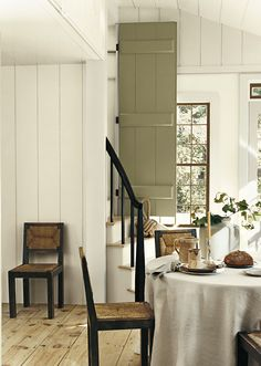 Soft, neutral colors for a casual dining room. Ralph Lauren Paint Plaster White and French Khaki