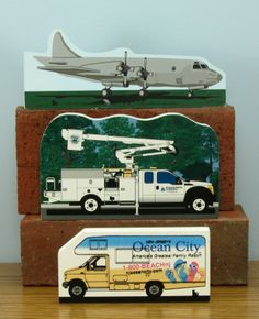 Your community includes things other than buildings! Here are examples of Cat's Meow keepsakes created for businesses within communities like yours. From top - airplane from a local Naval Air Station, Line truck for an Electric Cooperative who was celebrating 75 years, local tourist van in a seaside community. The sky is the limit when it comes to re-creating keepsakes for your town. Just look around. www.catsmeow.com