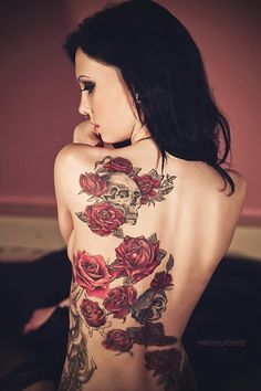 beautiful skull and rose tattoo but I would most likely do it without the skull. I would have it connected to my rose on R hip.. and then have it swirl up my back to R shoulder... or should I do opposite shoulder as shown here? So pretty!