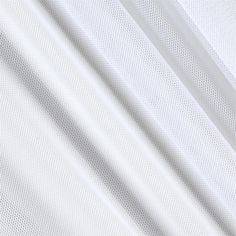 Telio Stretch Nylon Mesh Knit White from @fabricdotcom  With a soft hand and feel, this nylon shaper mesh fabric has four way stretch. With 50% vertical stretch and 25% stretch across the grain, this shape wear fabric can be used to line garments in order to  give the body a sleek and smooth silhouette. Perfect for use under sheer fabrics, linings, lingerie and more!