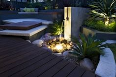 Clever courtyard design | GardenDrum  Subtle lighting, where you keep some areas dark, gives a courtyard a completely new look at night.  Design Janine Mendel, Cultivart