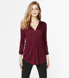 This burgundy henley blouse is perfect for a casual yet glamorous look! Pair it with one of our jeans and finish up the look with shiny accessories.