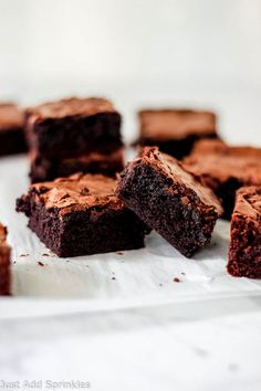 A completely #fromscratch recipe for the #best #homemade fudge brownies. These brownies are rich, thick and incredibly fudgy. You won't need another brownie recipe after you've tried this one! #justaddsprinkles #brownies #chocolate #fudgebrownies #easy #homemade #baking #desserts