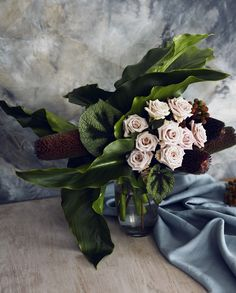 Unusual textures and scale create a dramatic impact, using a mix of  different sculptural flowers and other interesting elements.  The images shown are an indication of the style. We will craft an  arrangement which is similar, using seasonal product. If you have specific  requirements regarding flower selection, please contact the store directly.  Shown here is the medium size.
