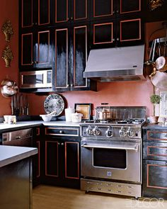 Black doesn't have to be limited to walls—the color dresses up the cupboards of a kitchen in a New York City penthouse. The room, which features walls painted in Benjamin Moore's  Pink Mix, merges country-elegant touches with industrial-looking appliances, including a Blue Star range, a Best hood, and a GE Monogram microwave.    - ELLEDecor.com