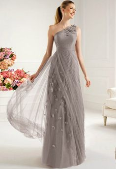 Bridesmaid dresses- I don't like the random flowers (or whatever they are) stuck to it, but the rest is amazing :)