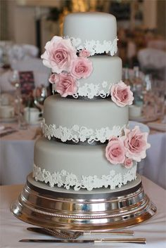 Grey wedding cake with rose detail..However, if you love the romance of roses, this lace and rose adorned creation is simply stunning. The grey tones will suit all colour schemes too.