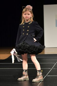#kidsfashion #kids #fashionshow #nyc #petiteparade #coat #shoes A model walks the runway wearing Angel's Face during petitePARADE at Children's Club January 2017 at Jacob Javits Center on January 9, 2017 in New York City. (Photo by Mike Coppola/Getty Images for petitePARADE )