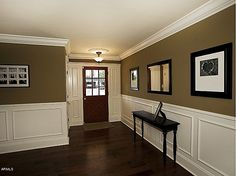 Wainscotting, trim and entry table.