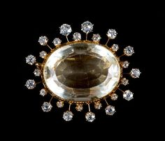 A Lady's Gold Citrine and Diamond Brooch : Lot 93