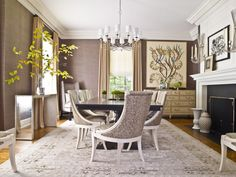 Dining room with subtle textured wall covering. Roughan Interior Design via Decorati.