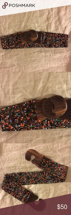 Beaded Waist Belt with Wooden Clasp Well-Kept beaded waist belt from Anthropologie. Fits nicely around waist. Wooden clasps fold into each other and are in good condition. No beads are missing! Anthropologie Accessories Belts