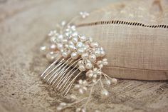 Hours of intricate work go into our beaded hair combs.This romantic hairpiece is encrusted with a variety of sizes using genuine freshwater pearls and