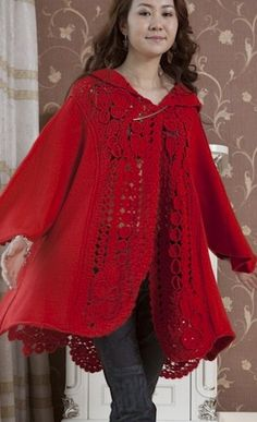 It's a coat with crocheted inserts. the link is to a Russian site which links to an Asian pattern (I think it's Japanese, but I can't tell). But the pattern is diagramed so it can be followed