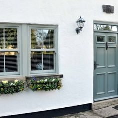 Modernise your home with high quality uPVC windows. Get in touch today for uPVC window prices. We have a stunning range of new windows you can choose from. Cottage Front Doors, Cottage Windows, House Windows, Windows And Doors, Tilt And Turn Windows, Bay Windows, Upvc Sash Windows, French Casement Windows, Green Windows