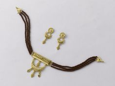 Choker: Weight - 8.200 gm, price Rs. 26670/- Earring: Weight -4.700 gm, price and Rs. 15300/-