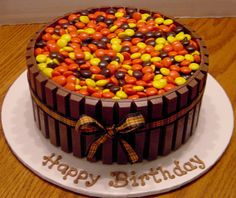 Reeces Pieces/Kit Kat Cake; its a chocolate layer cake, with peanut butter frosting...frosted all over, then break kit kat bars into two piece sections and press around the sides.(breaking them into sections helps them to follow the curves of the cake better)...then pour a bag of reeses pieces over the top...I don't like chocolate cake but I want to try and make it!