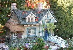 fairy house...I always thought this would be fun to do in the yard, have a fairy village....someday