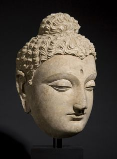 Head of Buddha  Gandhara 3rd - 4th c. stucco with traces of polychrome Height 45.0 cm