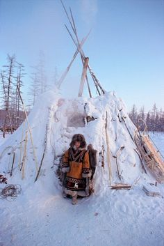 An Evenk woman leaving a traditional reindeer herders winter tent (Tordok). Kusur, Sakha (Yakut) Republic, Siberia.    © Bryan & Cherry Alexander Photography / ArcticPhoto    (The Evenks are one of the indigenous tribes of Northeast Siberia, their language belongs to the Manchu-Tungusic subbranch of the Altaic language group)