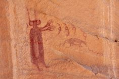 "A style of rock art called ""Barrier Canyon Style"": It's believed these works were created during the Archaic period by hunter-gatherers. The region has been occupied since at least 8,000 years ago, and there's evidence arguing the paintings are 1,500 to as much as 8,000 years old. During this time, before agriculture had been introduced to the region, it was sparsely populated (which combined with age is perhaps why there are only a few hundred Barrier Canyon Style panels)."