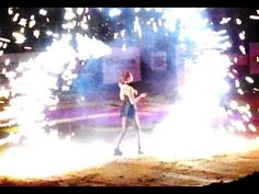 Bra-less woman plays with fire - artistic performance show