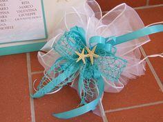 fiocchi decorativi con rete tiffany, tulle bianco, organza animata e stelle marine....
