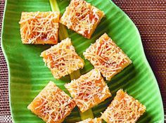 The grated cheese topping perfectly complements these sweet and tender cassava cakes.
