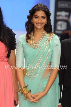 Sonam Kapoor wearing Amrapali pearl gold jewellery.