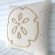 Idea for a DIY pillow: Spruce up a pillow with raffia, creating a sand dollar or starfish. Or paint a pillow, see here: http://www.completely-coastal.com/2011/09/painting-pillows.html