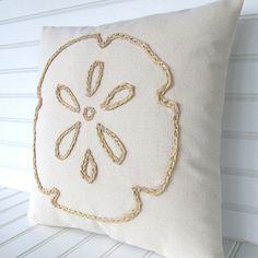 Sand dollar raffia pillow for your coastal living beach house