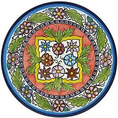 Bring southwestern appeal into your home with these vibrantly colored Talavera plates!  These beautifully handcrafted plates by the renowned studio of Tomas Huerta will make a perfect addition to any room in your home. With over 120 pieces in this collection, you are sure to find a uniquely designed plate that fits your style. Each authentic plate is made in Puebla, Mexico and is 100% lead free; chip resistant; and microwave, oven, and dishwasher safe! There is also an eyelet on each plate…