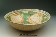 "Accession number: 18711 Collection place: Netherlands or London Production date: 1601-1633 Material: ceramic; earthenware Measurements: H 100 mm; DM 319 mm Museum Section: Post-Medieval Summary: English/Dutch tin-glazed ware shallow bowl with slightly everted rim standing on a footrim. From a brick- and chalk-lined well at the W end of the site, half in the S side of the central cutting, 8"" from the retaining wall."